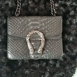 Black crocodile purse